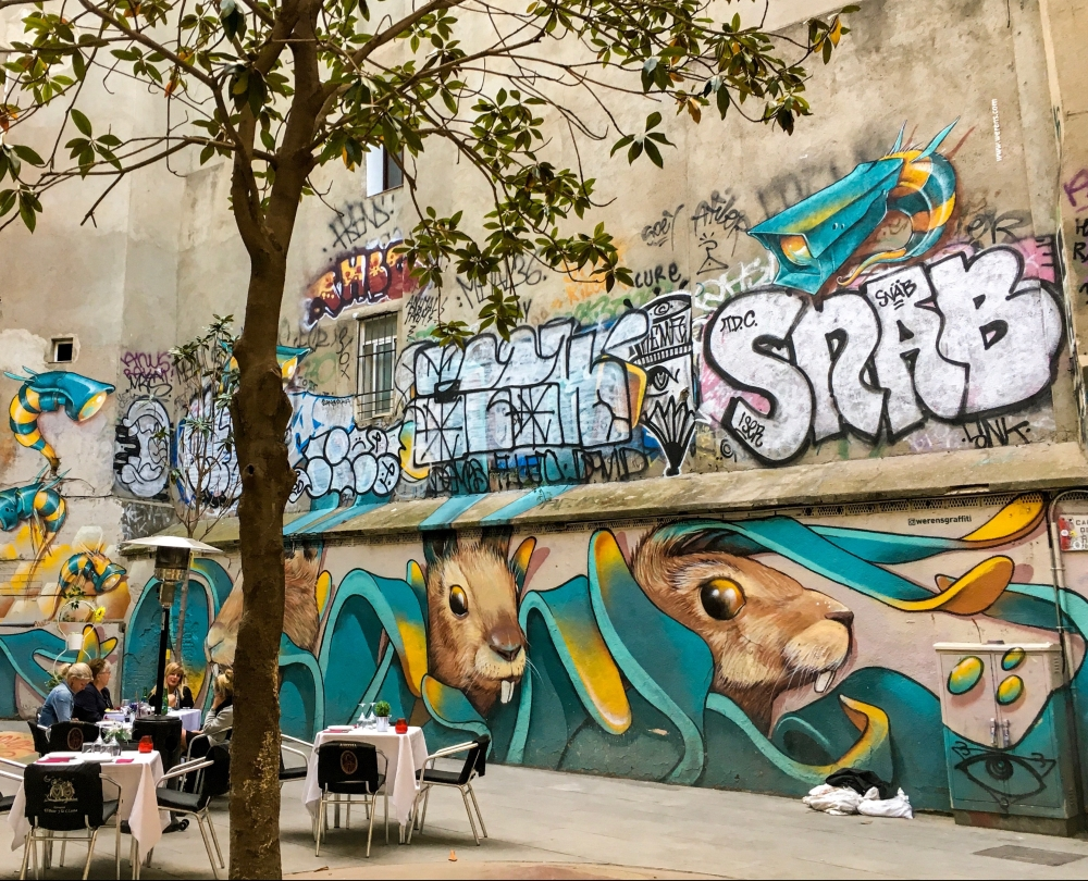 Graffiti in the one of the old town districts; Raval, El Born, Barri Gotic, in Barcelona.